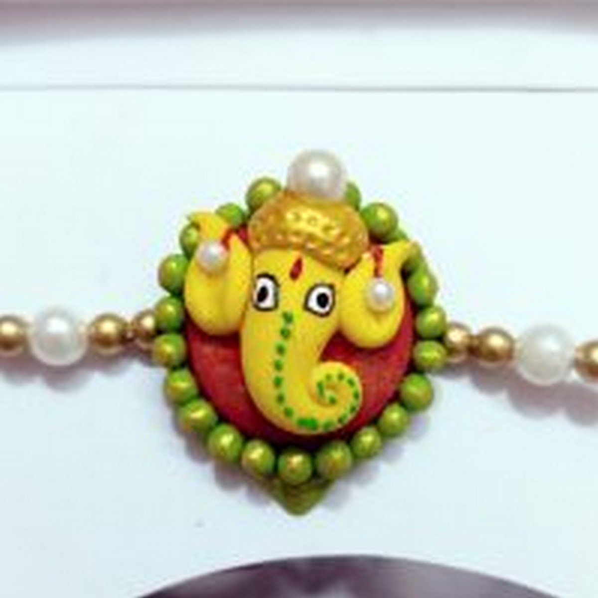 Beautiful Handmade Ganesha Rakhi For Your Brother  Beautiful handmade ganesha rakhi for your brother