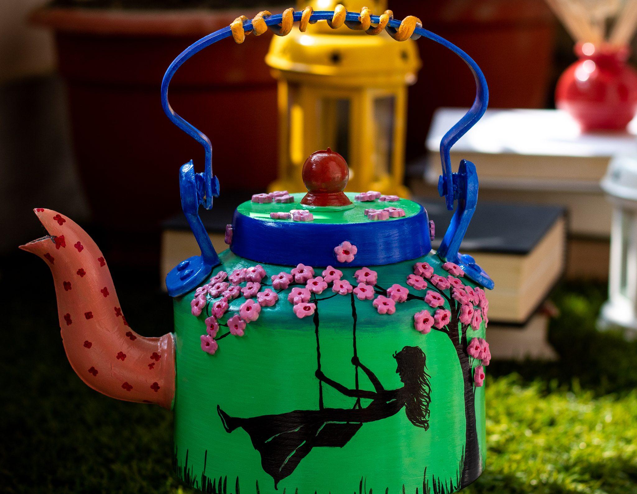 Creative Corner Girl on a swing themed kettle  Girl on a swing themed kettle