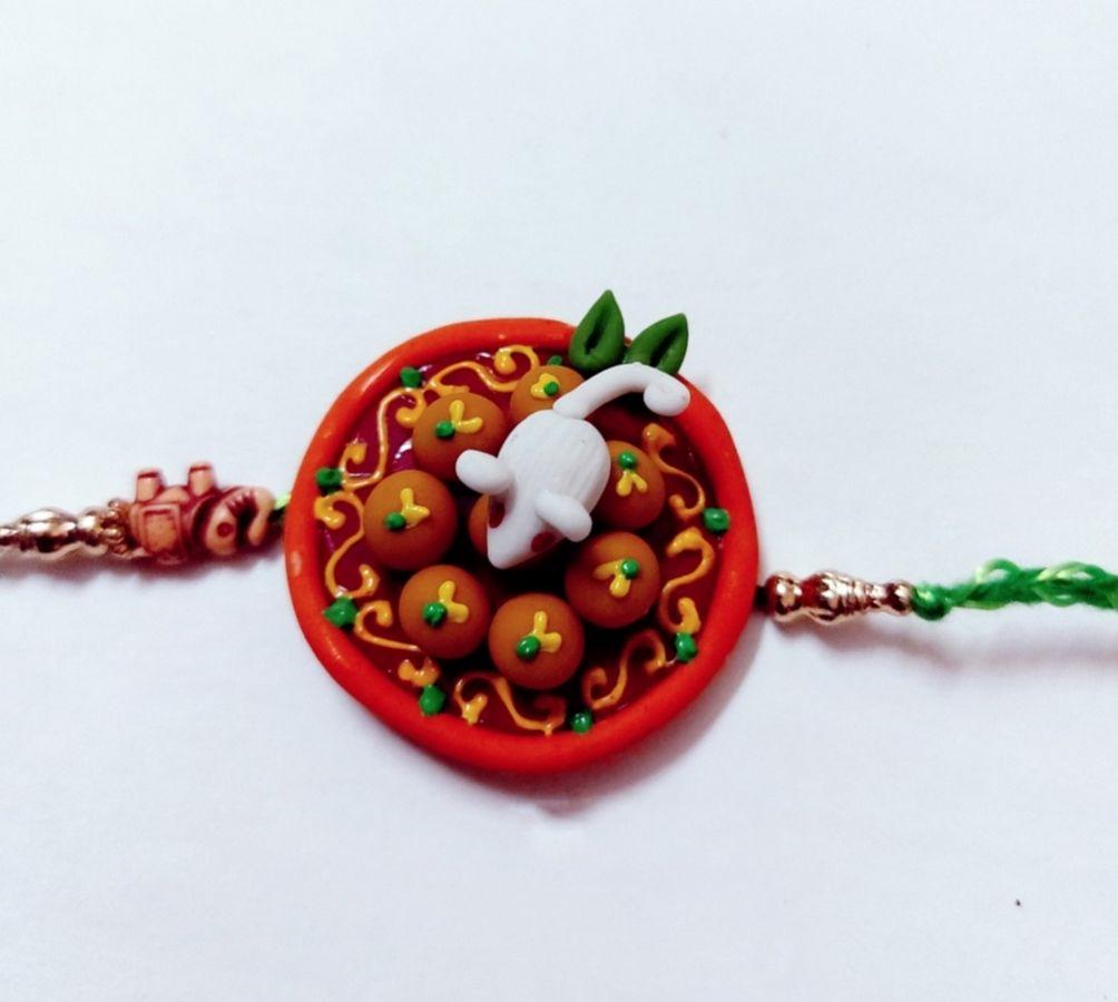 Handmade Customize Rakhi For Ganesha And Laddu Lovers  rakhi for ganesha and laddu lovers