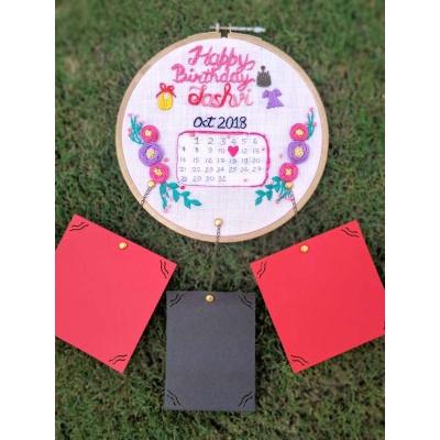 Hand Embroidered Wall Calendar HoopsThe Pink Umbrella  Hand Embroidered Wall Calendar HoopsThe Pink Umbrella